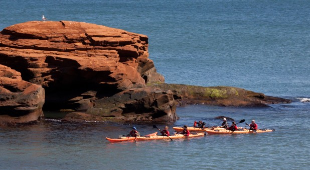 Paddling by the sandstone cliffs