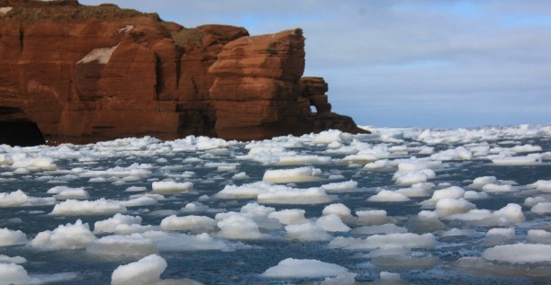 Magdalen Islands, red cliff, sea, ice floe, winter
